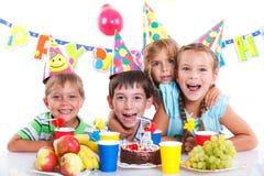 Kids with birthday cake Stock Photo