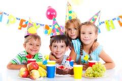 Kids with birthday cake Stock Photos