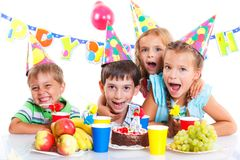 Kids with birthday cake Stock Photography