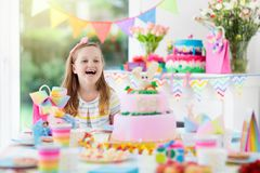Kids birthday party. Child with cake and presents royalty free stock images
