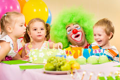 Kids on birthday party with clown. Kids celebrating birthday party with clown royalty free stock photography