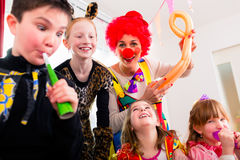 Kids birthday party with clown and lot of noise Royalty Free Stock Images