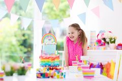 Kids birthday party. Little girl with cake. Royalty Free Stock Image