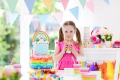 Kids birthday party. Little girl with cake. Royalty Free Stock Photo
