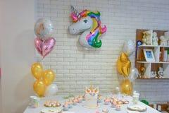 Unicorn party. Kids birthday party decoration and cake. Decorated table for child birthday celebration. Rainbow unicorn cake Royalty Free Stock Photography