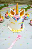Unicorn party cupcake and cake. Kids birthday party decoration and cake. Decorated table for child birthday celebration. Rainbow unicorn cupcake stock images