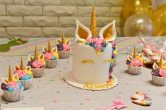 Unicorn party cupcake and cake. Kids birthday party decoration and cake. Decorated table for child birthday celebration. Rainbow unicorn cupcake royalty free stock photos