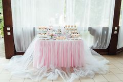 Kids birthday party decoration and cake. Decorated table. For child birthday celebration. Colorful textile in baby pastel color stock images