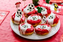 Kids birthday party Football theme. Doughnuts decorated with foo. Tballs and team dresses on toothpicks Stock Photography