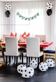 Kids birthday party Football theme. Table decorated in red and g. Reen colours with balloons in black and white Royalty Free Stock Photography
