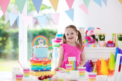 Kids birthday party. Little girl with cake. Stock Photo