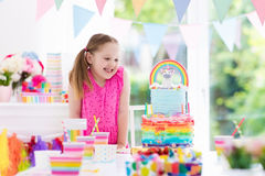 Kids birthday party. Little girl with cake. stock photography