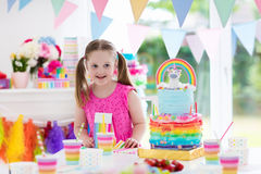 Kids birthday party. Little girl with cake. Stock Images