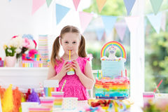 Kids birthday party. Little girl with cake. Royalty Free Stock Images