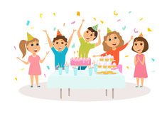 Kids birthday party. Table with cake and dessert. Children celebrate. Friends in hat dancing, jumping and laughing together. Group of happy girl and boy have Stock Photos