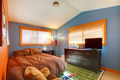 Kids biy bedroom with blue and brown. Stock Image