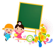 Kids and blackboard Stock Images