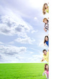 Kids with the blank banner. Perfect space to put any text. Royalty Free Stock Images