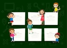 Kids with blank notepad board on green chalkboard background cartoon Stock Photos
