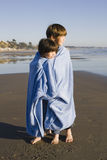 Kids in Blanket at Beach Royalty Free Stock Image