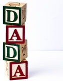 Kids block Dada vertical. Kids playing blocks wording dada vertically placed Royalty Free Stock Photos