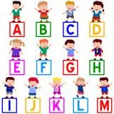 Kids & Blocks [A-M] Royalty Free Stock Image