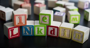 Kids blocks with the word LinkedIn as the social business network royalty free stock photos