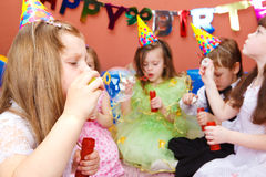 Kids blowing bubbles. At the birthday party Stock Photography