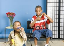 Kids blowing bubbles royalty free stock images