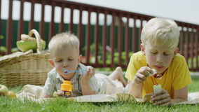 Kids blowing bubbles stock footage