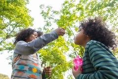 Kids Blowing Bubbles stock images