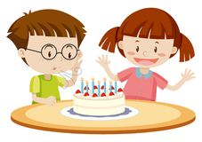 Kids blowing cake on birthday Stock Photography