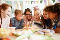 Kids Blowing Out Candles stock photo