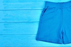 Kids blue textile summer shorts. Stock Photos