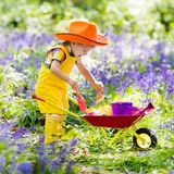 Kids in bluebell garden royalty free stock image