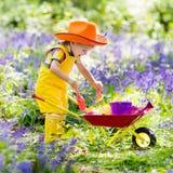 Kids in bluebell garden Royalty Free Stock Image