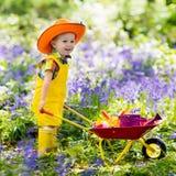 Kids in bluebell garden Royalty Free Stock Photo