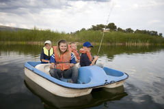 Kids in boat Royalty Free Stock Image