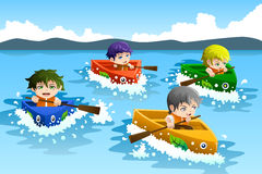 Kids in a boat race Stock Photo