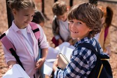 Kids with books on playground Royalty Free Stock Photography