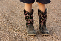 Kids Boot. A kids boots, standing on the gravel Stock Image