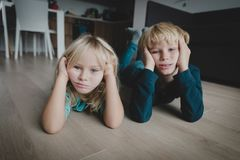 Stressed tired exhausted bored boy and girl tired being inside. Kids bored at home, stressed tired exhausted boy and girl tired being inside stock image