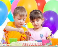 Kids boy and girl eating cake on party birthday Stock Image