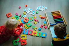 Kids- boy and girl- learning numbers, abacus calculation. Education stock images