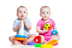Kids boy and girl play toys together. Kids boy and girl playing toys together Royalty Free Stock Photos