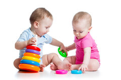 Kids boy and girl play toys together Stock Images