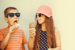 Kids boy and little girl eating ice cream. Royalty Free Stock Photo