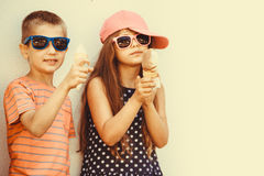 Kids boy and little girl eating ice cream. Royalty Free Stock Image