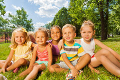 Kids, boys and girls on the lawn in park Stock Image