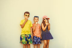 Kids boys and little girl eating ice cream. Stock Photography